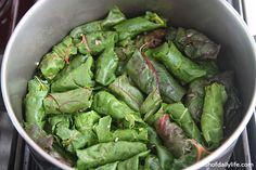 Stuffed swiss chard nestled in the pot as tightly as possible
