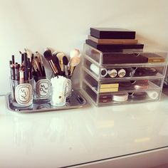 Use empty luxury candle glasses for storage! From into the Gloss - Muji organizer, Diptyque Candles on a silver tray