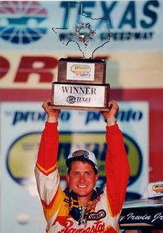 6.June 6, 1997: Rookie Kenny Irwin, driver of the No. 98 Raybestos/Ford Credit/Red Carpet Lease Ford, raises the winner's trophy in Victory Lane in celebration of his victory in the Pronto Auto Parts 400k, the inaugural NASCAR Craftsman Truck Series race.
