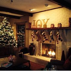 The mantle above the fireplace is a great place to add your own personal touch.  Don't forget your stockings!