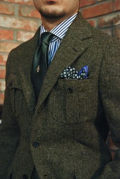 Harris Tweed Military Jacket made by Sartoria Vanni. Hand grenade needlepoint tie and hakerchief by Spalla.