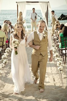 Bride + groom in J. Crew (Selma dress + British Khaki Linen suit) - cool look for the groom but would look better with turquoise/teal tie instead.
