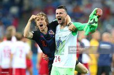4cd23d54666 Luka Modric and Danijel Subasic of Croatia celebrate their victory  following the 2018 FIFA World Cup
