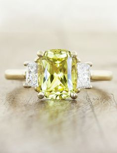 Yellow diamond with flanking white diamonds.  Untraditional Engagement Rings - MODwedding
