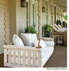 mr and mrs wall idea | It wouldn't be a southern porch without a porch swing; this one can ...