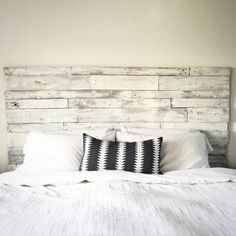 Farmhouse style, DIY Headboard made with pallet boards. LOVE this so much! Obsessed with pallet board furniture.  And I love that black and white Aztec throw pillow and the white bedding.