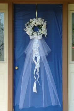 This photo gives me an idea!!! I could just repurpose a glass storm door and put my bridal veil behind it & attach the whole thing to the wall. This way I can display it. I could either do it Vertically or horizontally!