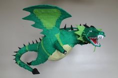 Hand made papier-mâché dragon piñata. Let your knight slay the dragon on his big day! Or, help save the princess from the fiery dragon! Pinata Dragon, Dragon Costume, Dragon Party, Clay Dragon, Dragon Crafts, Anniversaire Elmo, Paper Bag Princess Costume, Fiery Dragon, Dragons Love Tacos