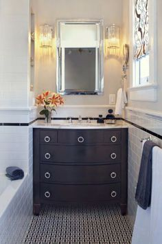 black dresser vanity, subway tile, black and white mosaic flooring