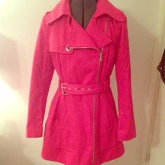 Gorgeous Hot Pink Guess Trench Coat Perfect for fall! Worn once, like new!! Absolutely gorgeous trench coat. Hot pink/Fuchsia color. Guess brand. Zips to the side for a an asymmetrical look. Ties around middle with adjustable belt. Bottom has an extra layer and creates a beautiful belled out look. Lines around top of sleeves and button detail on shoulders. Button detail flap in front and on the top of the back. Features light and hot pink flower fabric in lining. Guess Jackets & Coats Trench…