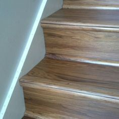 Luxury vinyl wood planks on stairs #LVT #vinylwood You'll find luxury vinyl available at our store Edgemont Floors, or at www.edgemontfloors.com