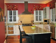 Beautiful custom kitchen with an island and subway tile backsplash by Suiter Construction Company