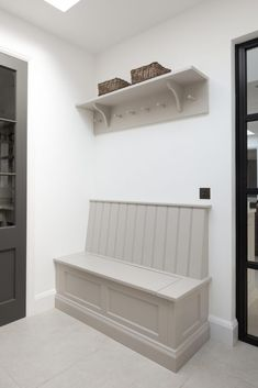 The boot room area at the Hampstead kitchen project has bench seating which provides a place to sit and put on shoes and is ideal for storing additional footwear and bags. Kitchen Seating, Banquette Seating, Kitchen Benches, Kitchen Booths, Hallway Seating, Hallway Storage Bench, Porch Storage, Hall Bench, Boot Room Utility