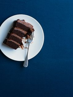 four tier chocolate layer cake with chocolate cream cheese icing