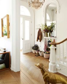 All the gorgeous crisp white paired with the warm wood floors is stunning!