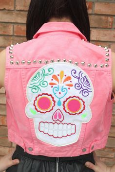 """street fashion style trends; pink denim jacket with embroidery patch Mexican """"Day of the Dead: graphic art"""