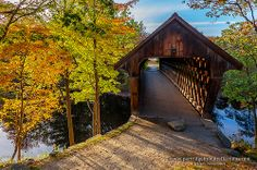 Henniker Bridge in Twilight Although it was built in 1972 the Henniker Covered Bridge, on the New England College campus, is still a classic. In this picture from my review of this year's Autumn season: