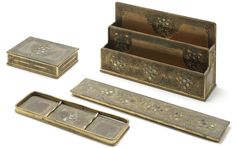 L.C Tiffany Studios  A Gilt-Bronze and Abalone Desk Set, circa 1910  comprising letter stand, blotter, pen holder and stationary box each with grape cluster motif  letter stand 13.8cm high, each piece stamped 'Tiffany & Co New York 1159'