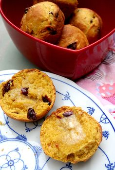 Buttered cranberry pumpkin rolls on plate