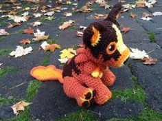 World of Warcraft Inspired: Molten Corgi Amigurumi by TheTallGrass Handmade plushie (in crochet Amigurumi style) of the Battle pet, Molten Corgi, from World of Warcraft!   Molten Corgi measures 8in tall in a fixed sitting position, 6in wide and 4in long. He can be ordered with or without the lava trail from his iconic idle animation in WoW. The Lava trail can also be chosen to be detachable (with velcro) or permanent (sewn on).  The Molten Corgi is made-to-order and can take from 1-3 weeks