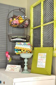fabric storage- I like the three-tiered stand- would be good for scraps and smaller pieces