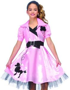 Description #49712 Dance the night away at a 1950's sock hop as a Hop Diva this Halloween. The shiny pink, knee length dress has a poodle embellishment on the bottom left side of the skirt and black l