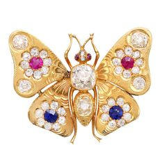 Victorian Butterfly Brooch ,15K gold butterfly brooch set with two rubies, two sapphires and 37 old mine diamonds.