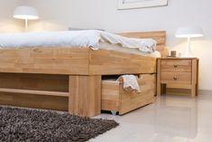 lit avec rangements en bois, tapis gris taupe et plancher gris clair