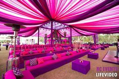 Purple and pink mehendi decor color scheme , pink and purple mehendi drapes, cushion covers ,