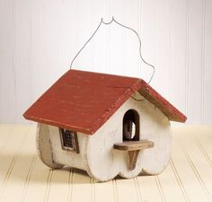 This bird house represents a deep woods Canadian cottage with red roof and simple white walls. It even has attic vents to keep your birds comfortable. Includes hanging hook. 20 x 9 x 8 inches.