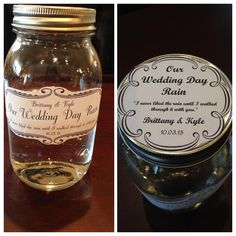 This fabulous couple had a mason jar to collect the rain on their wedding day. They are planning on using this special rain to christen their first child  #rainydaywedding