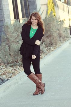 A cute black wrap cardigan for a chic but warm fall outfit. Pairing it with a bold green tee and contrasting it with brown riding boots gives this outfit dimension, not to mention an incredible outfit idea for thanksgiving or any fall occasion.