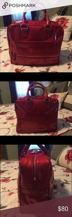 Calvin Klein Handbag Shiny Red Calvin Klein bag! Has only been used once. It is spacious and comes with pockets inside. There is a small black mark on the back but it's barely noticeable. Super fashionable! Open to negotiations! Calvin Klein Bags Totes