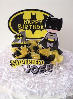 Decorate your birthday cake with this superhero batman cake topper. Made with clipart and cardstock this topper sits on a 1 high disc and decorated with color tissue paper. Personalized with name    WE DO NOT CLAIM OWNERSHIP OVER ANY OF THE CHARCTERS. ALL COPYRIGHTS BELONG TO THEIR RESPECTIVE OWNERS. PAYMENT IS STRICTLY FOR THE TIME AND CUSTOMIZATION OF YOUR ITEM(S). THE CHARACTER IMAGES ARE NOT BEING SOLD AND ARE PROVIDED FREE. .