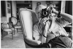 Cartier-Bresson takes pictures in his Paris apartment