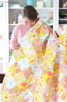 pink and yellow vintage sheet quilt. Flower power vintage sheets. Patchwork. 70 by 70 quilt.