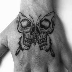 Left Hand Skull Grey Ink Moth Tattoo