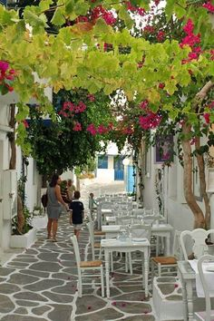 Tavern in an alley of Paros  by Man Grit