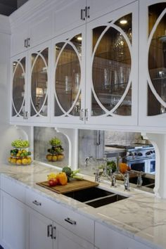 Great for a small space... circle detail glass doors, mirror back-splash.