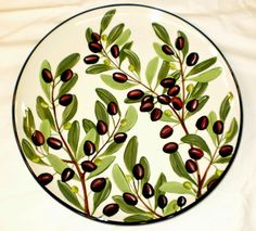Olive round platter, a current pattern painted by Geoff Graham in Vallejo, California at Cinnabar Ceramics. You can google the Cinnabar Ceramics Website if you want to know more.