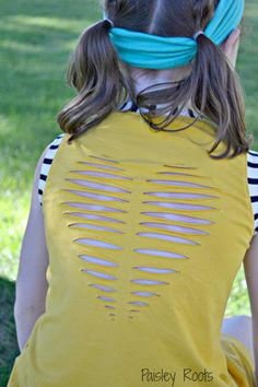 Turn an old tee into a brand new summer top with this insanely fast and easy no-sew project. All you need for this wonderful tee is an old t-shirt, scissors, a pen, and just ten short minutes. Learn how to add a heart to the back of any shirt with the Ten Minute T-Shirt Reconstruction. This upcycled t-shirt craft is so easy that it could serve as a fun and simple rainy day project for your kid stuck at home or as a summer camp craft.