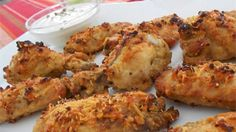 The trick to keeping these oven-baked chicken wings crispy, is parboiling the wings in a flavorful liquid, which helps season the chicken and produce a surface texture in the oven that your guests will swear came straight out of a deep fryer.