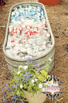 Keep your drinks ice cold for those hot wedding days! Shabby Chic Barn Wedding. Photography: http://www.TheAthensWeddingPhotographer.com Planning, Floral, and Event Design: http://www.WildFlowerEventServices.com Venue: The Barn on Belmont only in here http://designingweddings.net
