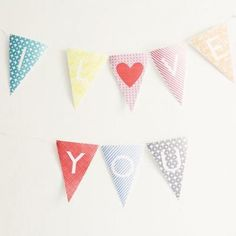 """Free Printable Alphabet Banner - the perfect solution when you need a banner for any event.  You simply click on the letters you need to customize your own words.  Create signs like """"Welcome Home"""", """"Happy Birthday"""", or with a baby's name for a shower or the name of a bride & groom."""
