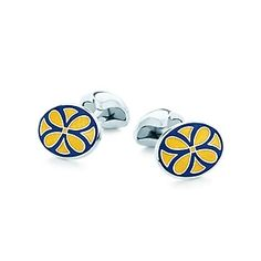 Oval cuff links in sterling silver with navy and yellow enamel finish.