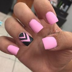 Awesome looking pink nail art design using baby pink matte polish. A lone black nail polish is painted in alternating zigzag lines to simply stand out.