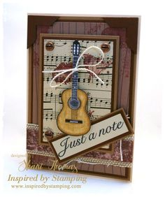 """Guitar """"Just a note"""" card, created with stamps from IBS Guitars and Big Notes sets, My Little Shoebox Up in the Air Woodgrain Love paper, cardstock, vintage sheet music, ribbon and brads."""