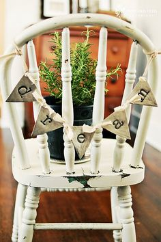Little chair banner, with a rosemary centerpiece