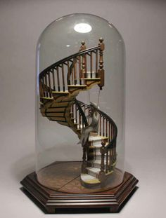 i love spiral staircases and the figure swinging from one, just makes it better. i'd like this as a little art piece