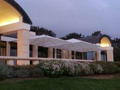 Uhlmann SidePost Umbrellas in a Country Club in California. Commercial Umbrellas, Patio Umbrellas, California, Club, Mansions, Country, House Styles, Outdoor, Home Decor